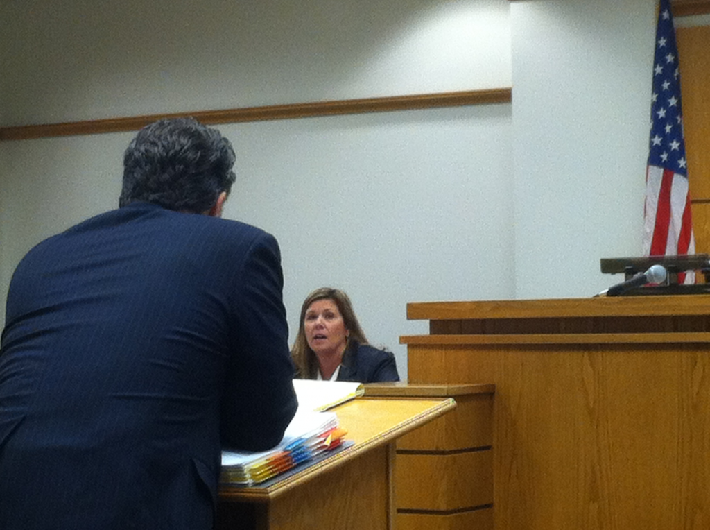 DEFENSE ATTORNEY WHITE LEANING ON AGENT MCMILLIAN