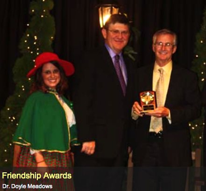 "TRAINER BOYZ PRESIDENT MICKEY MCCORMICK PRESENTING DOYLE MEADOWS WITH A ""FRIENDSHIP AWARD"""