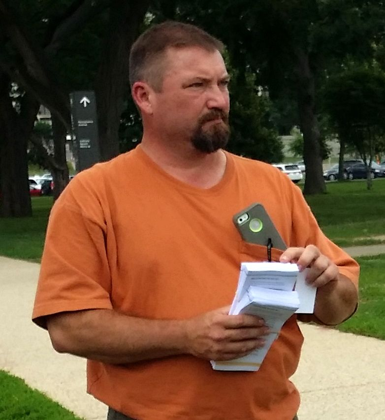 "MAN IN ORANGE WITH ""TWHGRO"" LITERATURE OPPOSING THE PAST ACT WHO ACCOMPANIED VIRGINIA DIRECTOR PAM MCKINLEY"