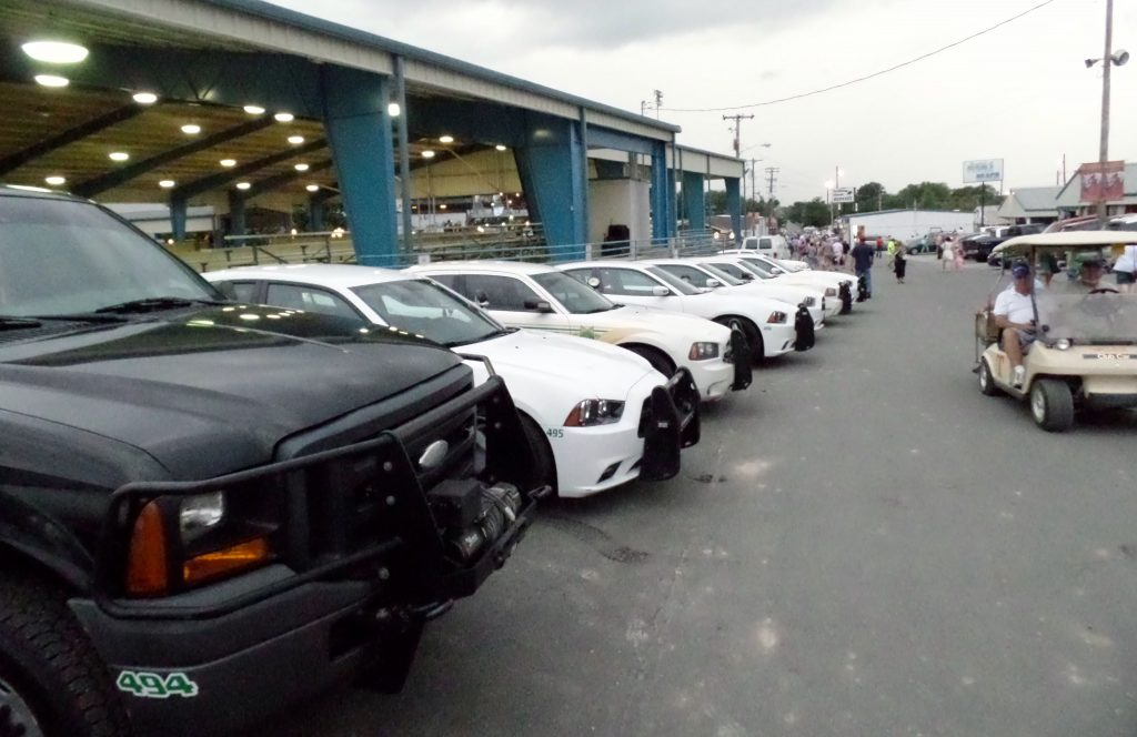 BEDFORD COUNTY SHERIFF CRUISERS ALL LINED UP AT CELEBRATION IN SHOW OF FORCE