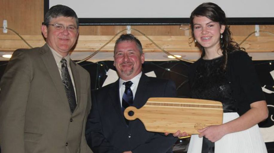 "(Left to Right) WHTA BOYZ President Mickey McCormick,  Assistant Trainer Casey Brooks Mutter and ""Chopping Board"" Award Presenter"