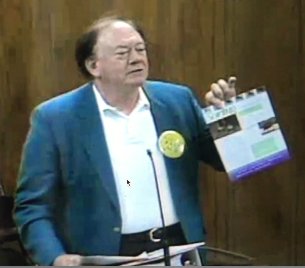 Citizens Campaign Representative Holding Up Soring Data Sheet - PCB City Council - April 28, 2016