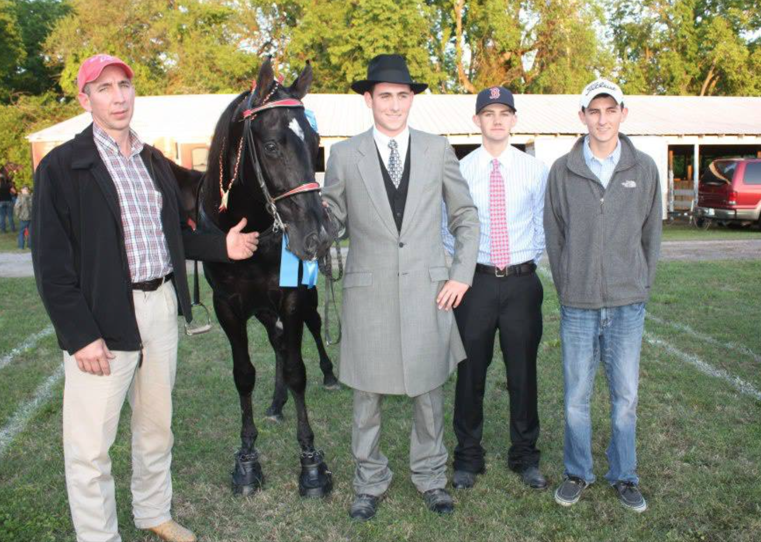 (Left to Right) Mr. Danny Burks, unidentified Horse, Hayden Burks, two unidentified individuals.